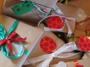 cutting costs at Christmas: brown paper packages tied up with string