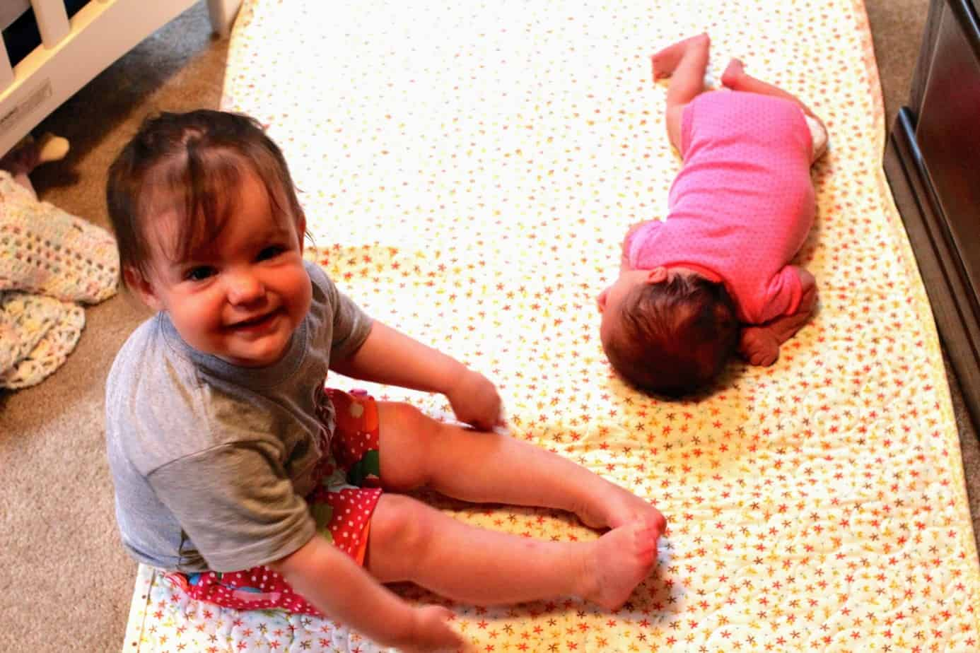 Should I move toddler out of crib for the baby? How to transition toddler to own bed; how to transition toddler to big bed; move toddler to big bed