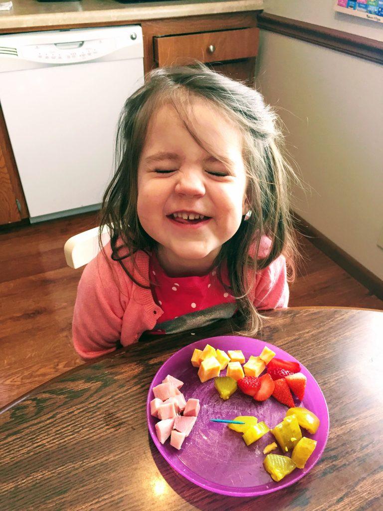 toddler eating veggies happily